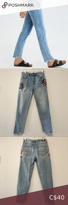 """American Eagle embroidered mom jeans light wash American Eagle embroidered high rise mom jeans in light wash. Distressed with a step hem. No flaws or damage Size 4. Denim is on the thinner side, cotton, no stretch. Approximate measurements laid flat: 15"""" waist, 11"""" rise, 25"""" inseam American Eagle Outfitters Jeans High Rise Black Ripped Mom Jeans, American Eagle Ripped Jeans, High Rise Mom Jeans, Black Skinnies, High Jeans, High Waist Jeans, Embroidered Mom Jeans, Cutout Boots, Light Jacket"""