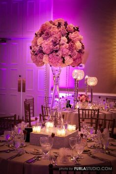 Photographer: Furla Studio, Via Yanni Design Studio; Stunning purple and pink floral wedding reception centerpiece