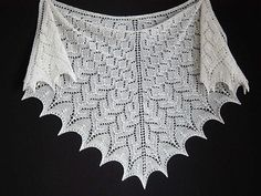 This shawl uses modified stitch patterns from Nancy Bush's Knitted Lace of Estonia and design inspiration from Evelyn A. Clark's Knitting Lace Triangles.