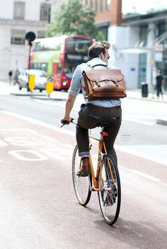 Nice backpack style briefcase. He'll look good whether arriving or leaving. -Lily #streetstyle