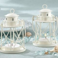 These lovely lighthouse tea light holders make for thoughtful, and practical favors for your guests. Set at each table setting, and they will also enhance your nautical themed decor.  #NauticalWeddingFavors #LighthouseTeaLightHolderFavors #NauticalDecorIdeas