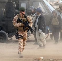 A member of Close Protection Unit Royal Military Police (CPU RMP), armed with a C8 CQB carbine fitted with Trijicon ACOG sight and grip pod, pictured in Iraq.