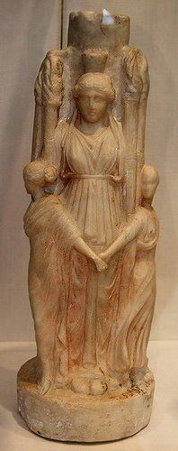 Marble statuette of Hecate Triformis, encircled by the Three Graces, Roman art, 1-2 century CE.