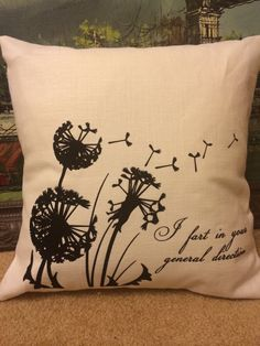 Get a little classy in your home with this Monty Python inspired quote pillow I fart in your general direction with dandelion fluff blowing in