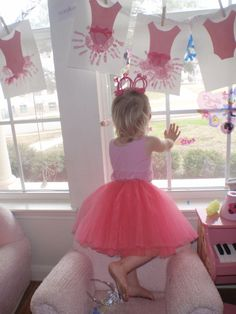 Make a ballerina craft at a birthday party. Hang them up as decoration for the party while they dry. Kids take them home. Lots more ballet birthday party ideas on this blog.