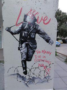 """"""" Amour."""" """" Trop de morts dans des guerres dénuées de sens """" / Street art. / Berlin, near Holocaust Memorial. / Germany. / Allemagne."""