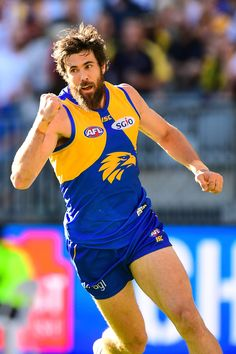 COLLINGWOOD has recalled young gun Darcy Moore for a crucial job on one of West Coast's returning twin towers in Josh Kennedy or Jack Darling for Sunday's blockbuster at the Melbourne Cricket Ground. West Coast Eagles, Young Guns, Thursday, Racing, Legs, Hairline, Stars, Towers, Cricket