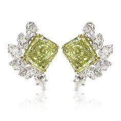 Cora International earrings, yellow diamonds, surrounded by mixed shape white diamonds, set in 18K yellow gold and platinum, $266,000, corainternational.com.