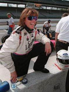 Lyn St. James jokes with fans after practicing for the 1996 Indianapolis 500. In 1992, St. James became the first woman to win the Indy 500 Rookie of the Year award.