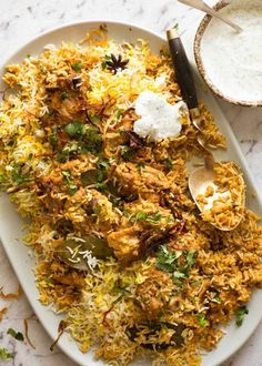 Chicken Biryani on a large serving platter, garnished with coriander with a side of minted yoghurt.Chicken Biryani on a large serving platter, garnished with coriander with a side of minted yoghurt. Curry Recipes, Asian Recipes, Healthy Recipes, Arabic Recipes, Healthy Meals, Healthy Food, Halal Recipes, Fast Recipes, Mexican Recipes