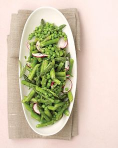 asparagus, peas and radishes with fresh tarragon. i can't wait to make this super simple, spring salad! love that alliteration too!