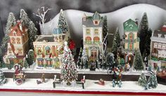 With limited space, I'm looking for a way to display Christmas Village.  This guy has done a beautiful job.