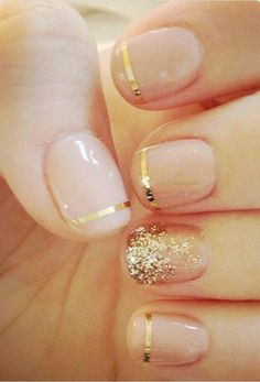 Nude nails with gold glitter and striping