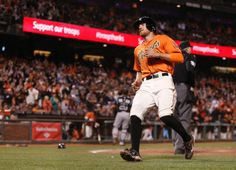 San Francisco Giants' Hunter Pence steals home on a wild pitch by Colorado Rockies pitcher Chris Martin during the seventh inning of a baseball game in San Francisco, Friday, June 13, 2014. (AP Photo/Beck Diefenbach)