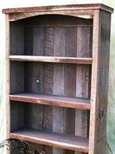 This bookcase is built from wood reclaimed from barns in the southern US, giving it a solid, rustic look. Description from dwellsmart.com. I searched for this on bing.com/images