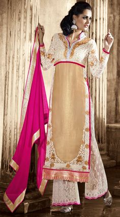 Fashionable dark cream faux georgette designer salwar kameez which is crafted with a zari, resham embroidery work on the yoke, sleeves and lower part, designer lace work on the border. Matching bottom and contrast pink dupatta attached with this outfit.This Salwar Kameez can be stitched in the maximum bust size of 42 inches, bottom length is 44 inches and Top length is 46 inches. Product Code 3FD4413768
