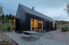 format elf nestles dark barn-shaped houses into bavarian forest - designboom | architecture