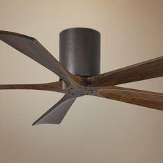 This hugger ceiling fan offers a modern look for your living space. Five walnut-stained solid wood blades. Style # at Lamps Plus. Industrial Outdoor Furniture, Industrial Bedroom, Industrial Design, Ceiling Fans Without Lights, Hugger Ceiling Fan, Ceiling Fan Makeover, Outdoor Ceiling Fans, Exterior Ceiling Fans, Bronze