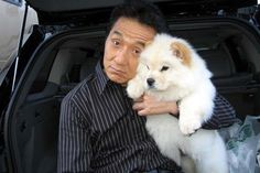 My favorite actor, Jackie Chan with an cream chow baby. :)