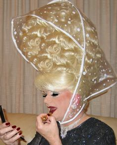~ ♛your hair should never be three times as large as your head. This plastic thingie will never protect this gigantic hair from ANY weather!