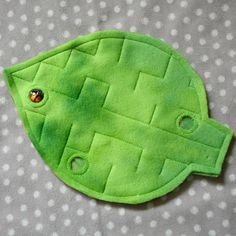 Leaf Peek-a-Boo Marble Maze with Ladybug This sweet marble maze is the perfect gift for any ladybug and nature lover! Three peek-a-boo vinyl windows allow you to see the bright ladybug appear as you work it through the maze. Made of super soft variegated green fleece with green