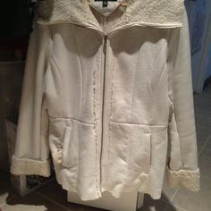 Jones of New York Cream coat Jones of New York cream protester coat. Beautiful coat - length comes to hip. Sleeves have detailed cuffs with enclosed zipper. Collar flaps over. Jones New York Jackets & Coats