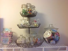 I like to use fun things for storage - check out my cupcake tiered stand with tiny jars, teapots and pitchers full of embellishments!