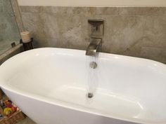 Features Solid Brass Construction For Durability And Reliability - Kohler bathroom tub faucets