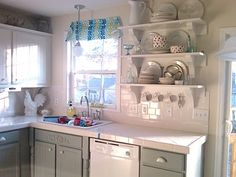 Painting Oak Cabinets White and Grey featured on remodelaholic.com #kitchen #diy #painting