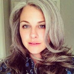 "This woman makes me want to just grow my gray hair out.  I look like the fuzzy-headed brunette ""before"" pictures."