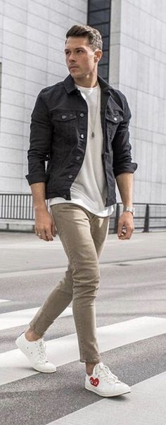 ea13fb13c0a Casual fall outfit inspiration with a black jean jacket white t-shirt tan  slim cut