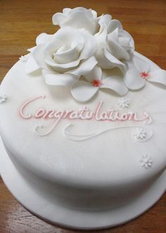 Traditional anniversary cake with white roses. Pin from shinyrubbiepeople.co.uk