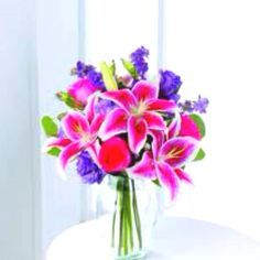 Star gazer Lillie's and pink roses are my favorite flowers!