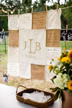 Quilt guestbook. Love display of center/sample squares of neutral colors with basket of squares for signing!