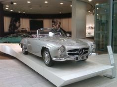 Mercedes Benz SL 190 and a photo of Emil Jellinek and his daughter Mercedes - inspiration for the Mercedes part of the brand name.