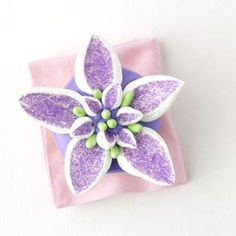 petal cupcakes - lavender colored sugar, marshmallows, good and plenty candies, lavender frosting, thetish