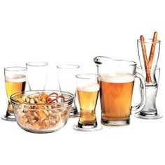 Entertain in style at your next game night with this home bar essential, perfect for a fun-filled evening with friends and neighbors.        Product: 6 Pilsner glasses1 Pitcher1 Serving bowl 8 Coasters    Construction Material: Glass    Color: Clear    Features:   Made in the USA    15 Ounces pilsner glasses   55 Ounces pitcher   80 Ounces serving bowl    Cleaning and Care: Dishwasher safe