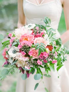 Julia carried a bright and loose bouquet filled with beautiful florals and foliage such as cafe au last dahlias, roses, anemone, and silver dollar eucalyptus. Floral Design by Encore Style.
