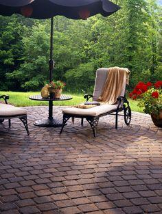 Belgard's Cambridge Cobble paver creates the perfect circular patio for relaxation.