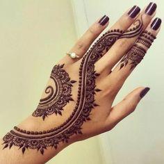 Henna - love the dark nail polish with the tattoo design.