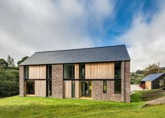 Sandstone-clad house in Wales designed by Hall + Bednarczyk to resemble local barns