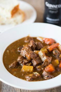 Guinness Beef Stew - Incredibly tender meat, potatoes and carrots, all swimming in a perfectly smooth and rich Guinness-spiked sauce. Absolutely delicious!