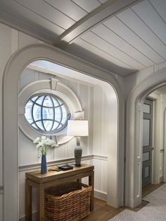 Gorgeous upstairs hall in a beachfront house in Quogue, NY by Robert A. Stern Architects with interiors by Steven Gambrel. The fact that that oval window is operable is everything. Architecture Details, Interior Architecture, Interior And Exterior, Interior Design, Florida Home Decorating, Cottage Decorating, Die Hamptons, Beachfront House, Gambrel