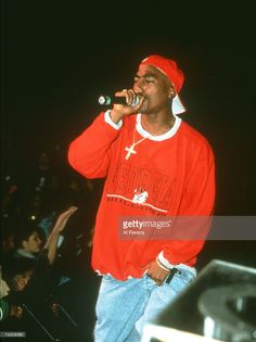 Rapper Tupac Shakur performs onstage in circa 1993 in New York, New York.