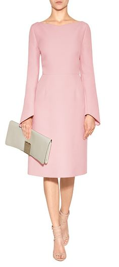 Detailed in a pretty shade of pink, this silk-infused wool dress from Valentino features long sleeves and asymmetrical cuffs #Stylebop