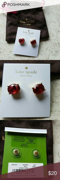 Kate Spade earrings Nwt. Pair of Kate Spade New York pinkish red stud. earrings gold around the stone. Comes with desk bag. kate spade Jewelry Earrings