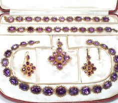 Antique Georgian Siberia, Russia Amethyst Parure Set In High Carat Yellow Gold, Closed Backed And Foil Settings And Oval Faceted Amethyst Consisting Of Necklace, Bracelets, Pendant Earrings And Pendant   c.19th Century