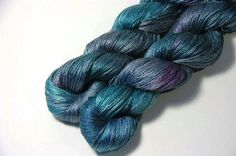 Lichtfaden Etsy 12/28/14 $22.50USD 437yds Pure Silk Lace Teals and greys with purples. One of a Kind = REALLY NOT Repeatable. Our yarns are random dyed, so no skein is quite like the other and