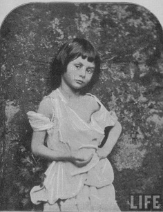 Portrait of Alice Liddell, child whom Alice in ALICE IN WONDERLAND is based, posing as a begger-child taken by Lewis Carroll (pen name of Charles Dodgson) from THE LIFE AND LETTERS OF LEWIS CARROLL by Stuart Dodgson. c.1859