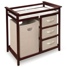 Motherhood is hard enough. Let this cherry modern changing table make it just a little bit easier. Three fabric drawers on the side keep all your babys necessities in one place. Features a terrycloth changer with a belt that holds up to 30 pounds.